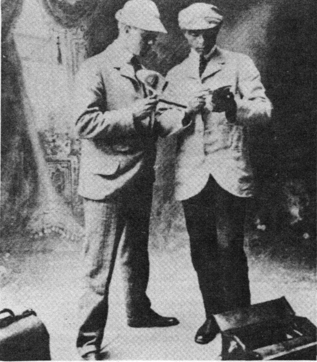 Sandburg and his sales partner, Frederick Dickinson (at left) pose with one of their stereoscope and cards.